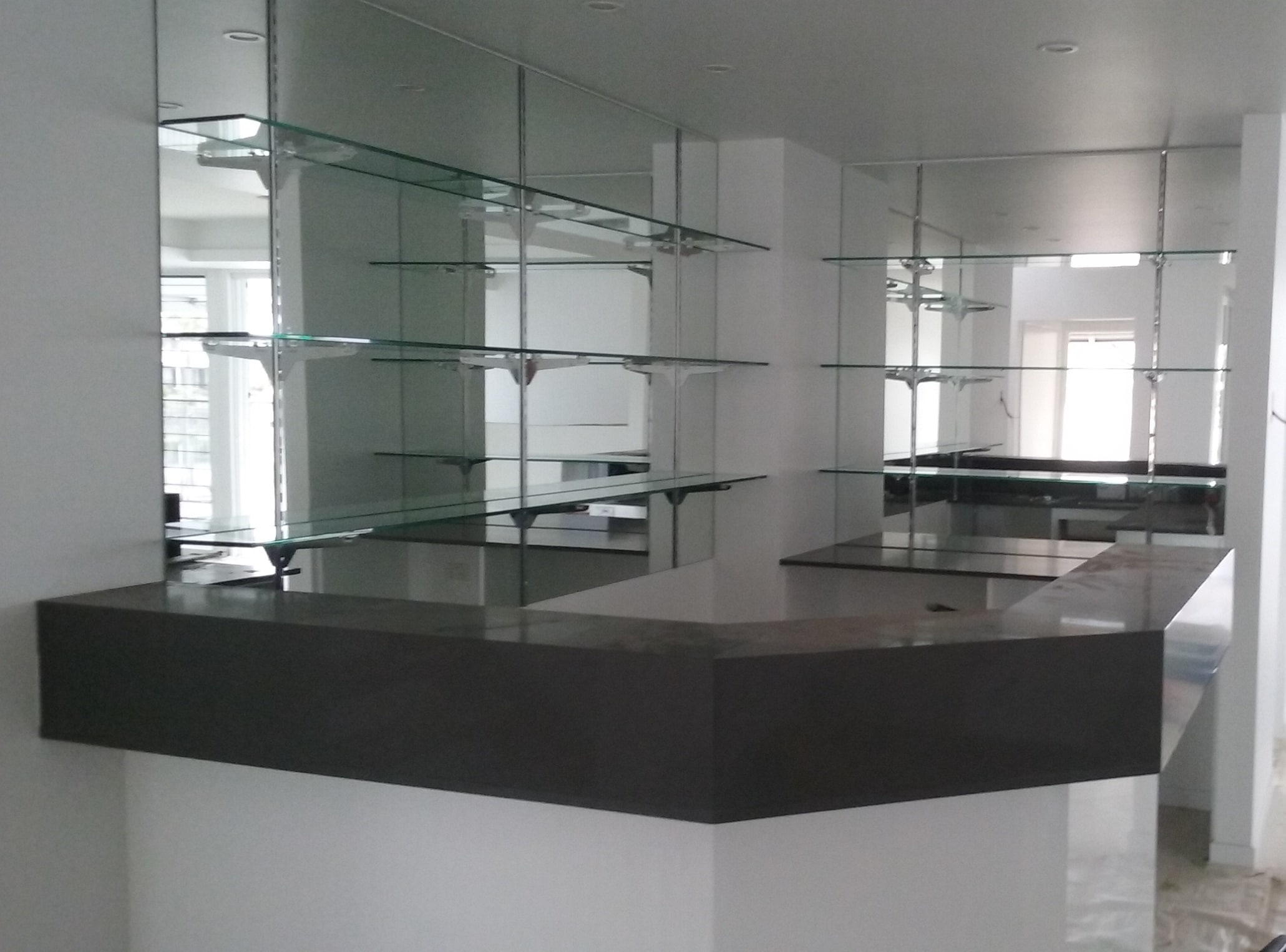 Glass shelves for bathrooms - Mirror Wall With Glass Shelving By Graphic Glass Services Qld